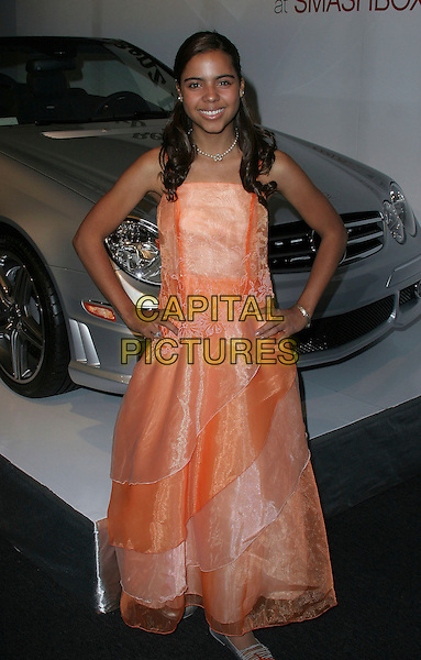 ALEXANDRA ROSE REIGER.The Mercedes-Benz Spring 2007 L.A. Fashion Week at Smashbox Studios, Los Angeles, California, USA,.19 October 2006..full length orange dress hands on hips.Ref: ADM/ZL.www.capitalpictures.com.sales@capitalpictures.com.©Zach Lipp/AdMedia/Capital Pictures.