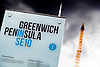 A banner for 'Greenwich Peninsula se10' with a spire from the O2 arena in the background