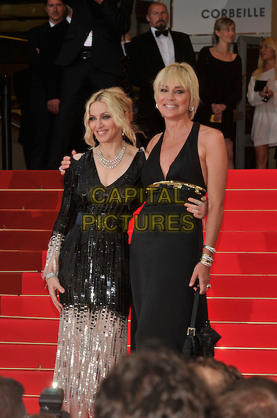 "MADONNA & SHARON STONE.Red Carpet Arrivals for the premiere of  ""I Am Because We Are"" at the Palais des Festivals  during the 61st Cannes International Film Festival, Cannes, France, May 21st 2008..half length black halterneck gold sequined dress sheer see through arms around waist each other boobs breasts nipples.CAP/PL.©Phil Loftus/Capital Pictures"