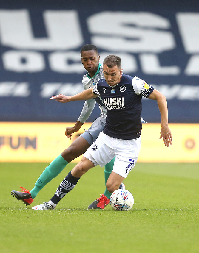 Millwall's Jed Wallace and Blackburn Rovers' Tosin Adarabioyo<br /> <br /> Photographer Rob Newell/CameraSport<br /> <br /> The EFL Sky Bet Championship - Millwall v Blackburn Rovers - Tuesday July 14th 2020 - The Den - London<br /> <br /> World Copyright © 2020 CameraSport. All rights reserved. 43 Linden Ave. Countesthorpe. Leicester. England. LE8 5PG - Tel: +44 (0) 116 277 4147 - admin@camerasport.com - www.camerasport.com