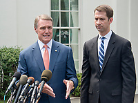 United States Senator David Perdue (Republican of Georgia), left, and US Senator Tom Cotton (Republican of Arkansas), right, speak to reporters outside the White House after meeting US President Donald J. Trump to discuss their proposed legislation to enact a skills-based immigration system called the Reforming American Immigration for a Strong Economy (RAISE) Act that they claim would also result in a lower level of immigration. Photo Credit: Ron Sachs/CNP/AdMedia
