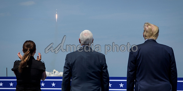 In this photo released by the National Aeronautics and Space Administration (NASA), President Donald Trump, right, Vice President Mike Pence, and Second Lady Karen Pence watch the launch of a SpaceX Falcon 9 rocket carrying the company's Crew Dragon spacecraft on NASA's SpaceX Demo-2 mission with NASA astronauts Robert Behnken and Douglas Hurley onboard, Saturday, May 30, 2020, from the balcony of  Operations Support Building II at NASA's Kennedy Space Center in Florida. NASA's SpaceX Demo-2 mission is the first launch with astronauts of the SpaceX Crew Dragon spacecraft and Falcon 9 rocket to the International Space Station as part of the agency's Commercial Crew Program. The test flight serves as an end-to-end demonstration of SpaceX's crew transportation system. Behnken and Hurley launched at 3:22 p.m. EDT on Saturday, May 30, from Launch Complex 39A at the Kennedy Space Center. A new era of human spaceflight is set to begin as American astronauts once again launch on an American rocket from American soil to low-Earth orbit for the first time since the conclusion of the Space Shuttle Program in 2011. <br /> Mandatory Credit: Bill Ingalls / NASA via CNP/AdMedia