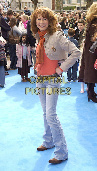 """BONNIE LANGFORD.At the UK Film Premiere of """"Ice Age 2: The Meltdown"""",.Empire Cinema, Leicester Square, London, .England, April 2nd 2006..full length jeans orange top scarf.Ref: CAN.www.capitalpictures.com.sales@capitalpictures.com.©Can Nguyen/Capital Pictures"""