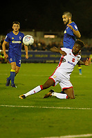Milton Keynes' Aaron Tshibola holds off AFC Wimbledon's George Francomb during the Sky Bet League 1 match between AFC Wimbledon and MK Dons at the Cherry Red Records Stadium, Kingston, England on 22 September 2017. Photo by Carlton Myrie / PRiME Media Images.