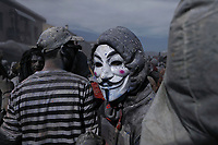 Pictured: Flour wars participants in Galaxidi, Greece. Monday 11 March 2019<br /> Re: Clean Monday (Monday of Lent) celebration of flour wars (Alevromoutzouroma) in the town of Galaxidi, which coincides with the beginning of the Greek Orthodox Lent in Greece. The origins of the custom are unclear, however it appears in its current form since the mid-19th century.<br /> Locals and visitors of all ages gather to collect large quantities of flour which they throw to each other. Various types of coloring is added for effect while people paint their faces with charcoal.