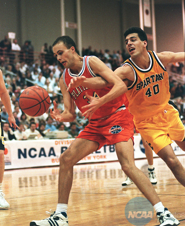 Caption: Manchester's Mark Finley (#40) tries to steal the ball from Wisconsin's John Paulsen (#34) during the Division III Men's Basketball Championship March 18, 1995, in Buffalo, New York. Wisconsin defeated Manchester 69-55. John Hickey/NCAA photos.