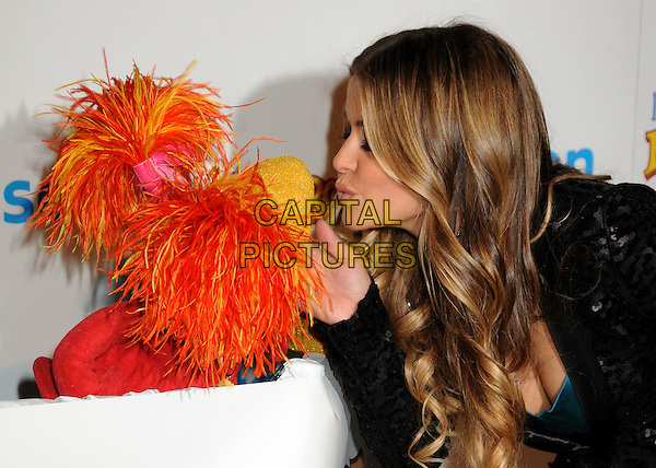 RED FRAGGLE & CARMEN ELECTRA.The Dr. Romanelli Fraggle Rock Clothing Collaboration & The Anita Ko Fraggle Rock Costume Jewelry Collection in Partnership with Volkswagen Host A Toy Drive to benefit the L.A. Mission held at Kitson, West Hollywood, California, USA..December 9th, 2009.half length black sequins sequined jacket muppet blue teal silk satin profile kiss kissing puckering lips .CAP/ADM/BP.©Byron Purvis/AdMedia/Capital Pictures.