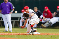 Davidson Wildcats first baseman Andrew Barna (24) stretches for a throw during the game against the Western Carolina Catamounts at Wilson Field on March 10, 2013 in Davidson, North Carolina.  The Catamounts defeated the Wildcats 5-2.  (Brian Westerholt/Four Seam Images)