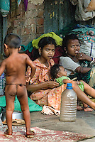 A family lives on the streets in the slums of Kolkata. It is estimated that 10 percent of Kolkata's total population of 45 million are homeless and living on the streets or in shanties. Conservative estimates put the number of homeless children in the city around 100,000.