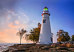 The Marblehead Lighthouse In The First Light Of Dawn On A Foggy Morning Over Lake Erie At Marblehead Ohio, USA