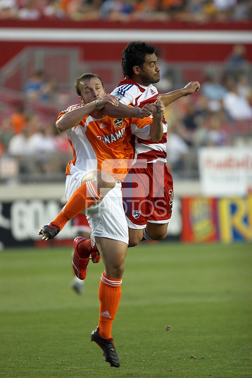 Houston Dynamo's Eddie Robinson (2) and FC Dallas' Carlos Ruiz (20) battle for a header at Robertson Stadium in Houston, TX on Saturday May 6, 2006. The Houston Dynamo defeated FC Dallas 4-3.