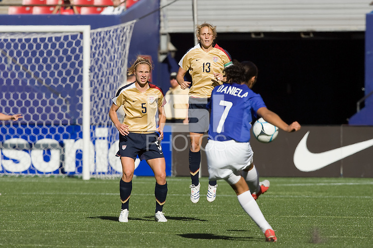 Brazil's Daniela attempts a free kick over a USA wall of Lindsay Tarpley and Kristine Lilly. USA defeated Brazil 2-0 at Giants Stadium on Sunday, June 23, 2007.