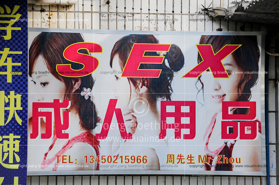 CHINA Guangzhou, billboard of Sex Shop / Guangzhou (Kanton) , Werbeplakat eines Sexshops