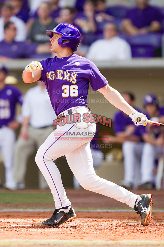 Austin Nola #36 of the LSU Tigers follows through on his swing against the Wake Forest Demon Deacons at Alex Box Stadium on February 20, 2011 in Baton Rouge, Louisiana.  The Tigers defeated the Demon Deacons 9-1.  Photo by Brian Westerholt / Four Seam Images