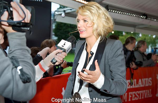 The Netherlands, Utrecht, 22 September, 2011. .Nederlands Film Festival.Photo: Nadine Maas.Rode Loper Premiere Me & Mr Jones on Natalee Island, van Paul Ruven.Hanna Verboom op rode loper