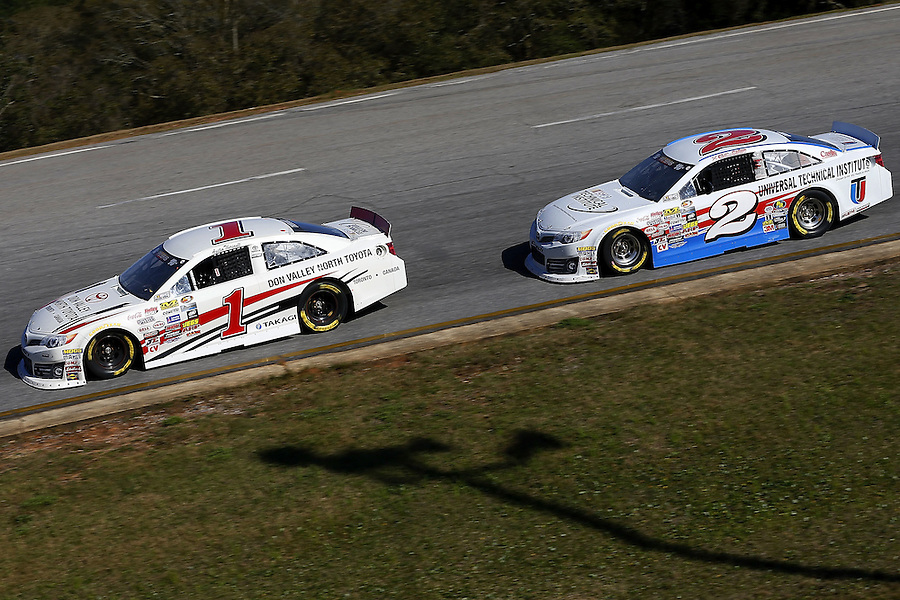 MOBILE, AL - MARCH 13: Austin Theriault, driver of the #1 Don Valley Toyota, leads Collin Cabre, driver of the #2 UTI/NTI Toyota, during the NASCAR K&N Pro Series East Mobile 150 on March 13, 2016 in Mobile, Alabama.  (Photo by Jonathan Bachman/NASCAR via Getty Images)