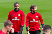 Ashley Williams and Joe Allen share a joke during the Wales open Training session ahead of the opening FIFA World Cup 2018 Qualification match against Moldova at The Vale Resort, Cardiff, Wales on 31 August 2016. Photo by Mark  Hawkins / PRiME Media Images.