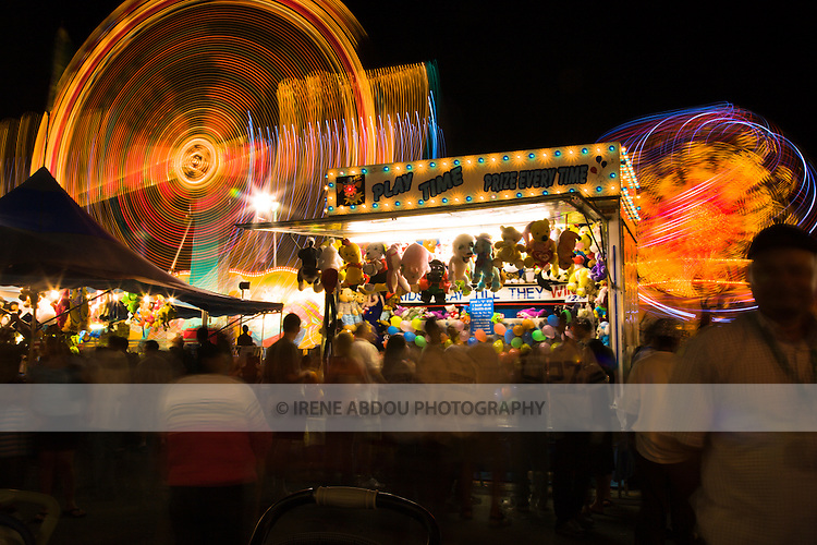 Residents enjoy the games and carnival rides at the 2007 Montgomery County Agricultural Fair in Gaithersburg, Maryland.
