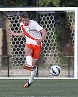Syracuse University defender Oyvind Alseth (2) passes the ball. Boston College (maroon) defeated Syracuse University (white/orange), 3-2, at Newton Campus Field, on October 8, 2013.