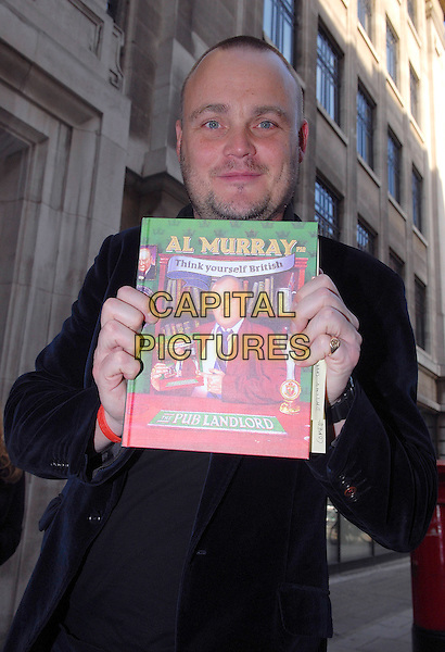"AL MURRAY .seen leaving Radio 2, London, England, UK, October 13th 2009..half length blue velvet jacket book holding ""think Yourself British"" Pub Landlord .CAP/IA.©Ian Allis/Capital Pictures."