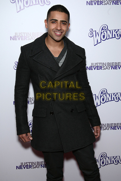 "JAY SEAN .Special Screening of ""Justin Bieber: Never Say Never"" at the Regal 42nd Street E-Walk Cinemas, New York, USA, 2nd February 2011..half length trench coat black smiling .CAP/LNC/TOM.©LNC/Capital Pictures."
