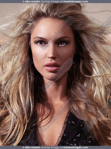 Portrait of a beautiful woman with long blond flying hair
