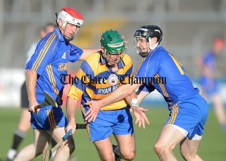Ruan's Jonathan Clohessey gathers under pressure. Photograph by Declan Monaghan