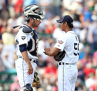 Detroit Tigers pitcher Fu-Te Ni #59 talks with catcher Max St. Pierre during a spring training game vs. the Boston Red Sox at Joker Marchant Stadium in Lakeland, Florida;  March 15, 2011.  Boston defeated Detroit 2-1.  Photo By Mike Janes/Four Seam Images