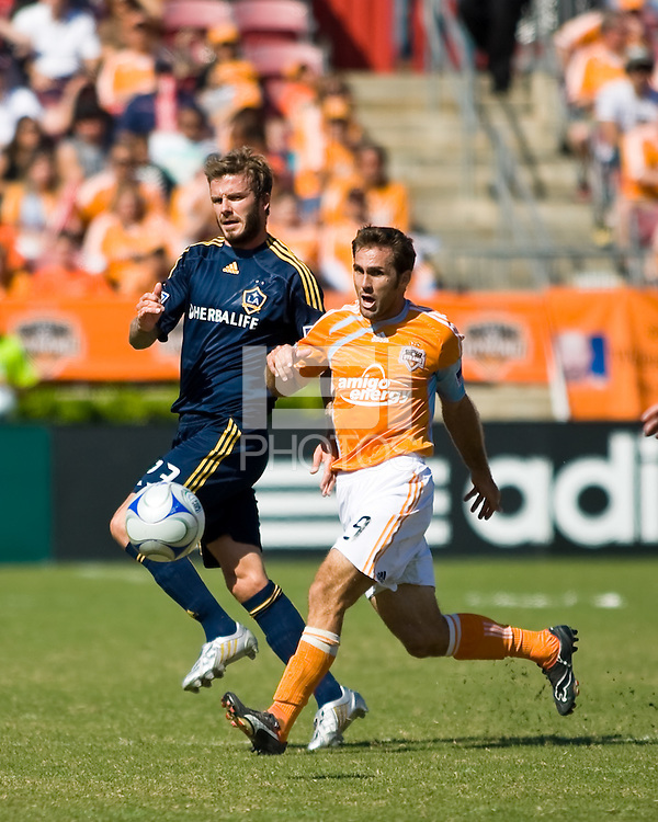 Houston Dynamo midfielder Brian Mullan (9) gets in front of Los Angeles Galaxy midfielder David Beckham (23). Houston Dynamo tied Los Angeles Galaxy 0-0 at Robertson Stadium in Houston, TX on October 18, 2009.