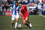 Vitolo of Sevilla FC fights for the ball with Victor Diaz of Deportivo Leganes during their La Liga match between Deportivo Leganes and Sevilla FC at the Butarque Municipal Stadium on 15 October 2016 in Madrid, Spain. Photo by Diego Gonzalez Souto / Power Sport Images