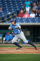 Charlotte Stone Crabs shortstop Alec Sole (23) bunts during a game against the Clearwater Threshers on April 12, 2016 at Bright House Field in Clearwater, Florida.  Charlotte defeated Clearwater 2-1.  (Mike Janes/Four Seam Images)