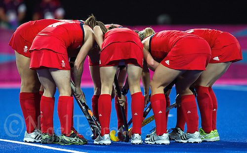08 AUG 2012 - LONDON, GBR - Great Britain players huddle before a penalty corner during the London 2012 Olympic Games women's semi final match against Argentina at the Riverbank Arena in the Olympic Park, Stratford, London, Great Britain .(PHOTO (C) 2012 NIGEL FARROW)