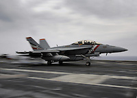 An F/A-18F Super Hornet assigned to VFA-2 Bounty Hunters recovers aboard USS Abraham Lincoln.