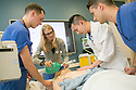 Fourth-year medical students work together to figure out a patient's ailment and administer the proper treatment in the Simulation ICU of the Trent Semans Center for Health Education. From left are Tyler Hobbs, Gillian Smelick, Phillip Tseng, and Christophe Hansen-Estruch.