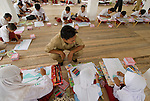 """Kids work diligently on a drawing contest that follows the theme of their Pride Campaign: """"When the forest is looked after, people prosper"""""""