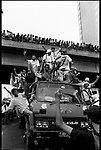 Summer '98-- Jakarta, Indonesia -- People rejoice at the anarchy in the streets during a protest on a hike in oil prices to the consumers.