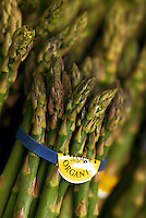 Organic asparagus in the produce section of a grocery coop