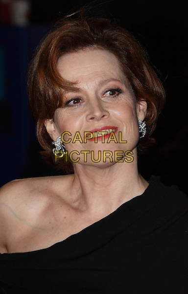 "SIGOURNEY WEAVER.Arrivals - World Premiere of ""Avatar"", Odeon Leicester Square, London, England. .December 10th, 2009 .headshot portrait black red lipstick smiling make-up earrings diamond silver .CAP/ROS.©Steve Ross/Capital Pictures."