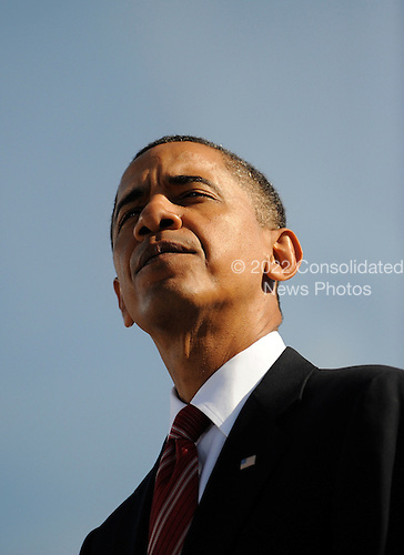 United States President Barack Obama looks on during ceremony and moment of silence at the Pentagon Memorial to mark the 9th anniversary of the terrorist attacks, in Arlington, Virginia, Saturday, September 11, 2010..Credit: Olivier Douliery - Pool via CNP