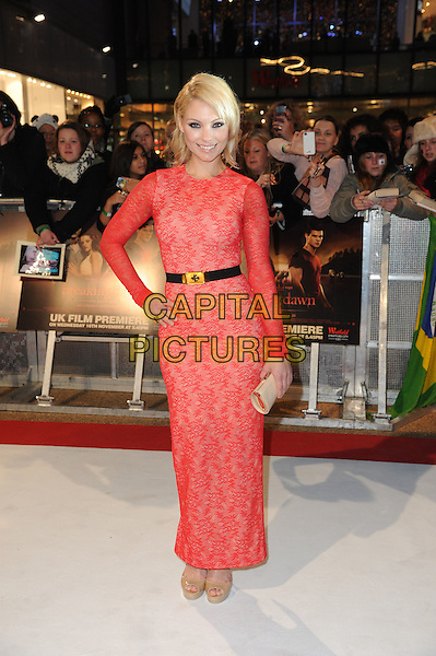 MyAnna Buring.'The Twilight Saga: Breaking Dawn - Part 1' UK film premiere at Westfield Stratford City, London, England..16th November 2011.full length red lace dress black belt hand on hip beige clutch bag.CAP/CAS.©Bob Cass/Capital Pictures.