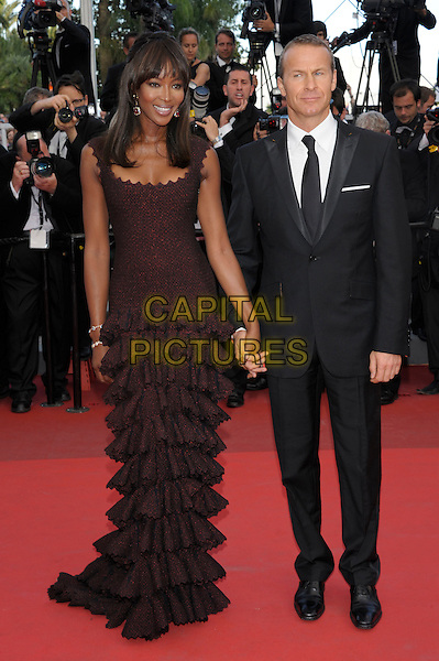 NAOMI CAMPBELL & VLADISLAV DORONIN .attends 'The Beaver' premiere 64th International Cannes Film Festival, France, 17th May 2011..full length black dress  brown ruffles ruffle tiered couple suit tie long maxi sleeveless holding hands .CAP/PL.©Phil Loftus/Capital Pictures.