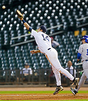 First baseman J.T. Chargois #14 of the Rice Owls can't reach a wild throw as J.T. Riddle #10 of the Kentucky Wildcats runs past the bag at Minute Maid Park on March 4, 2011 in Houston, Texas.  Photo by Brian Westerholt / Four Seam Images
