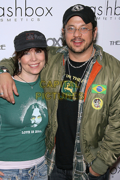 "ANNIE DUKE & JOSEPH D. REITMAN.Special VIP Viewing of ""Hedwig & The Angry Inch"" - Arrivals held at The Roxy, West Hollywood, California, USA..April 3rd, 2006.Photo: Zach Lipp/AdMedia/Capital Pictures.Ref: ZL/ADM.half length green baseball cap hat.www.capitalpictures.com.sales@capitalpictures.com.© Capital Pictures."