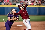 OKLAHOMA CITY, OK - JUNE 04: Sis Bates #22 of the Washington Huskies tags out Dani Morgan #1 of the Florida State Seminoles during the Division I Women's Softball Championship held at USA Softball Hall of Fame Stadium - OGE Energy Field on June 4, 2018 in Oklahoma City, Oklahoma. (Photo by Tim Nwachukwu/NCAA Photos via Getty Images)
