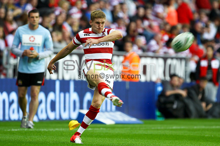 PICTURE BY ALEX WHITEHEAD/SWPIX.COM - Rugby League - Super League - Wigan Warriors v Castleford Tigers - DW Stadium, Wigan, England - 27/07/12 - Wigan's Sam Tomkins kicks for goal.