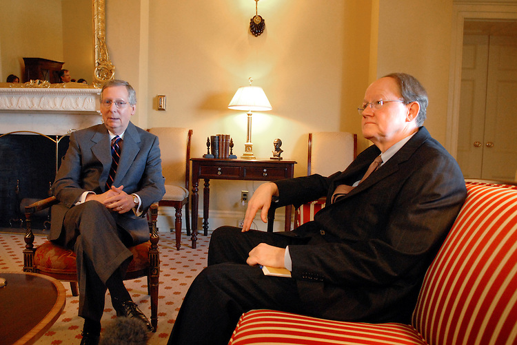 Senate Minority Leader Mitch McConnell, R-Ky., left, sits with Michael McConnell, who is nominated for the position of National Intelligence Director replacing John Negroponte