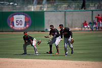 San Jose Giants outfielders Logan Baldwin (1), Heliot Ramos (13), and Bryce Johnson (23) celebrate a victory after a California League game against the Stockton Ports on April 9, 2019 in Stockton, California. San Jose defeated Stockton 4-3. (Zachary Lucy/Four Seam Images)