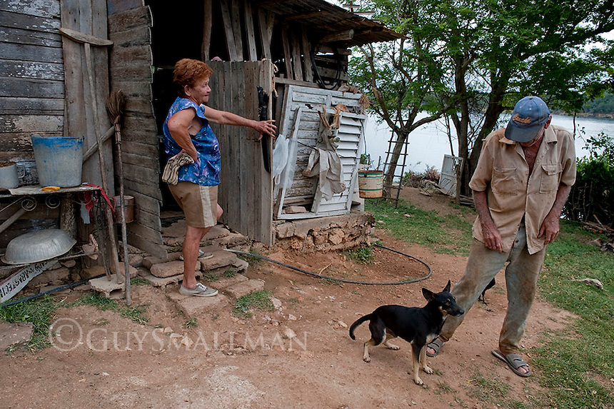 Rural scene Holguin Province, Cuba. 9-12-10 A farmer with his wife and dog.