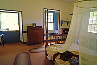 Built in 1834, the original missionary home and museum of the Rev. Dwight Baldwin can be visited on Front Street in Lahaina. Seen here is the bedroom area of the home.