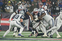 FOXBOROUGH, MA - NOVEMBER 24: New England Patriots Runningback Sony Michel #26 on the run with Dallas Cowboys Defensive tackle Maliek Collins #96 in on the tackle during a game between Dallas Cowboys and New England Patriots at Gillettes on November 24, 2019 in Foxborough, Massachusetts.